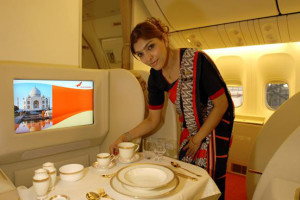 Air India stewardess in newly designed uniforms in the Dreamliner's First Class cabin. Source: Air India